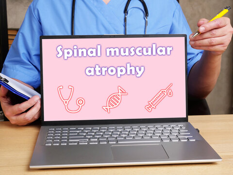 Medical concept about Spinal muscular atrophy with phrase on the piece of paper.
