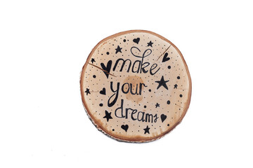 make your dream - inspirational phrase on wood, handwriting. Isolated on white