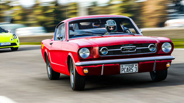 Spain, Badajoz ; january 06 2021: 1965 ford mustang gt 2+2 fastback in videogame project cars 3