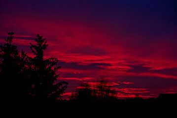 red sunrise over country houses
