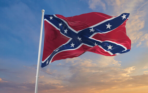Large rebel flag waving in the wind . the Confederate battle or Dixie flag. Stars and Bars. Vintage United States flag