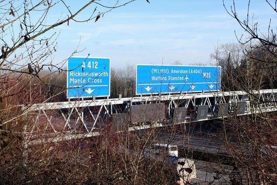 M25 London Orbital Motorway signs at Junction 17 in Chorleywood, Hertfordshire