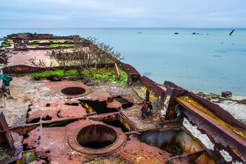 old ship wreck on the beach by the sea