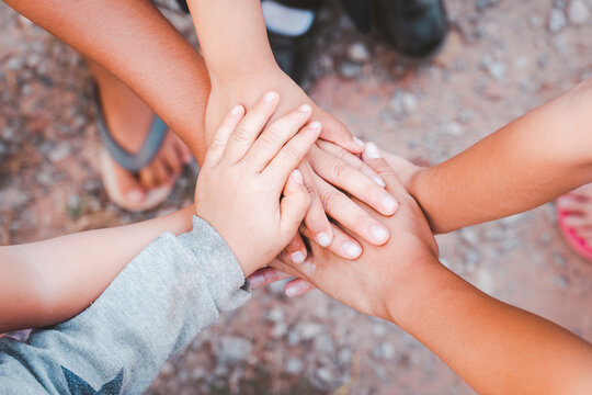 diverse hands joined together from child hand friendship