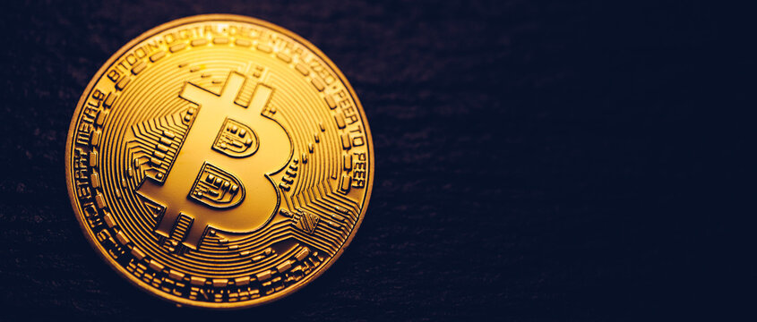 Crypto currency golden coin with bitcoin symbol on isolated on black background. Bitcoin Coin on black background. Bitcoin cryptocurrency.  Cryptocurrency Coin Concept.