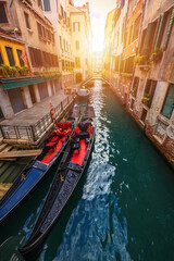 Canal with gondolas in Venice, Italy. Architecture and landmarks of Venice. Venice postcard with Venice gondolas.