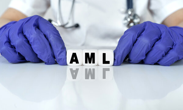 The doctor put together a word from cubes AML. Acute Myeloid Leukemia