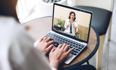Woman talk speak using laptop computer and video conference online with doctor and stethoscope...