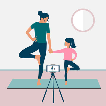 A mother and daughter stand in a tree pose and record a video yoga lesson on their smartphone. Yoga with kids. The concept of Stay home. Home activities during quarantine. Online courses. Eps 10.