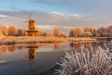Dutch winter landscape with scaffolding mill along the Hunze river - Hunzedal, Drenthe, Netherlands. Fotobehang