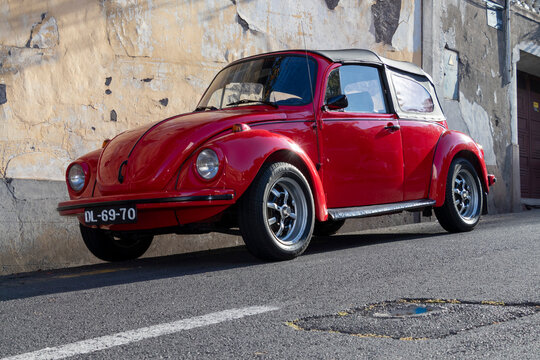 Funchal, Madeira, Portugal. 2019-04-30. Street of Funchal . Fusca 1303 on the street. Sunset. Selective focus
