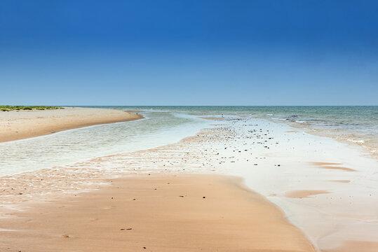 Empty sandy beach near Norra Austen on the Swedish island Fårö in the Baltic Sea in summer. Long-term exposure