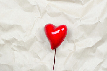 Valentine's day background. Two hearts on a crumpled beige background