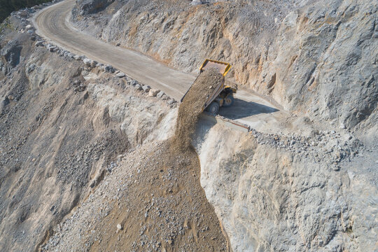 Mining truck unloading from aerial view