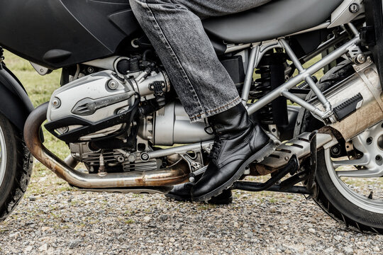 Close-up of a foot in boots doing gear shifts on a motorcycle