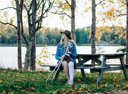injured woman sat with her crutches enjoying the fresh air