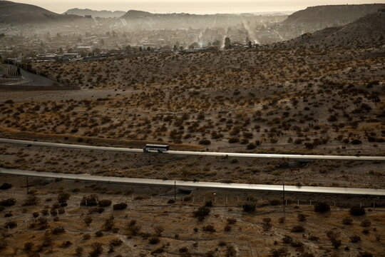 A bus passes near the Anapra neighbourhood on the outskirts of Ciudad Juarez