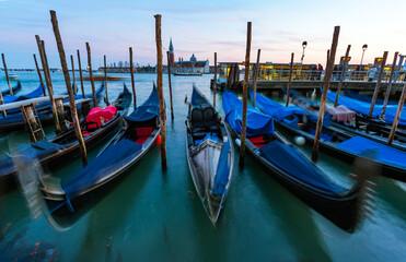 Gondolas Moored In Water