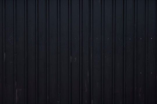 Old wall made of black cargo ship container
