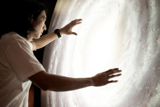 Man experiencing the universe at a planetarium