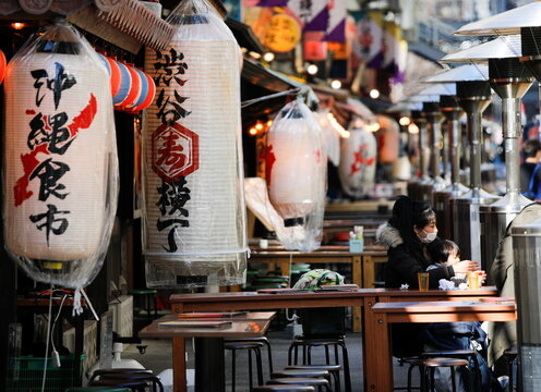 A woman with a child has lunch at an open-air restaurant amid coronavirus disease (COVID-19) outbreak in Tokyo