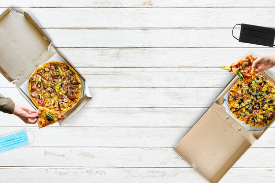Eating pizza with social distancing in the new normal way