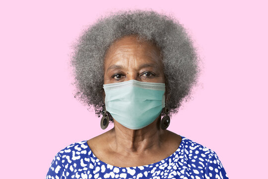 Mature woman wearing mask psd mockup for Covid-19 prevention cam