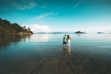 Romantic middle aged couple enjoying beautiful beach