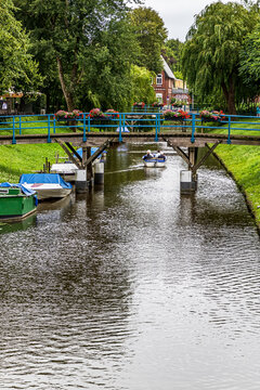 "Beautiful summer city landscape at the canal close to marketplace in the ""Dutch town"" of Friedrichstadt, North Friesland district, Schleswig-Holstein, Germany"