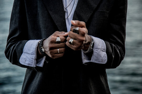 Closeup shot of the hands of a stylish African American male with rings