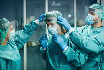 Doctors wearing ppe equipment face surgical mask and visor fighting against corona virus outbreak -...