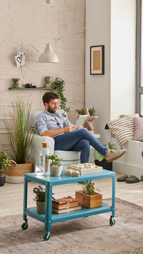 Man in the room, corner interior style, listening to the music with laptop and working from home. Modern decoration style.
