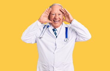 Senior handsome grey-haired man wearing doctor coat and stethoscope smiling cheerful playing peek a boo with hands showing face. surprised and exited Wall mural