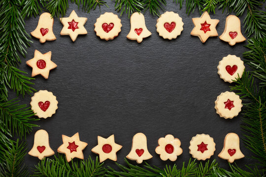 christmas cookies chocolate stars with raspberry crunches on slate table