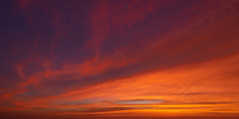 Sunset sky. Abstract nature background. Dramatic blue with orange colorful clouds in twilight time.