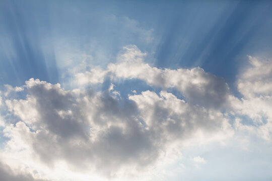White cloud and sun rays in sky