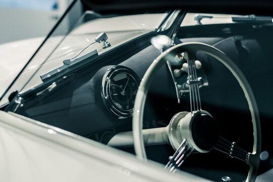 STUTTGART, Germany 6 March 2020: The Porsche 356 Speedster Prototype 1954 Convertible. Details of windscreen, steering wheel, speedometer and dashboard.  1949 Porsche 356-2 Gmünd Cabriolet