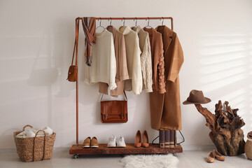 Fototapeta Modern dressing room interior with rack of stylish shoes and women's clothes obraz