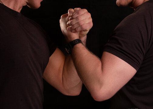 Brotherhood of men. Men hold hands tightly. Strong men. Brotherhood of men.