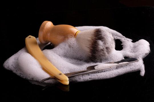 Shaving brush and razor. Foam, razor and shaving brush close-up.