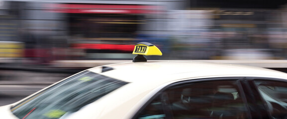 Blurred Motion Of Taxi In City