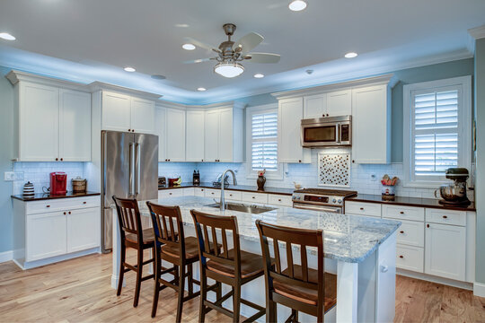 Beautiful kitchen remodel with white cabinets and new appliances.