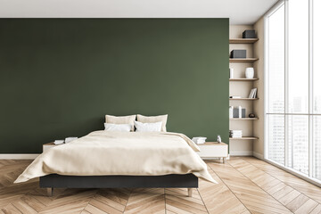 Green and beige bedroom, bed with linens bookshelf near window