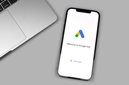 Google Ads (AdWords) mobile app logo on the screen iPhone, notebook closeup. Google is the biggest Internet search engine in the world. Moscow, Russia - December 5, 2020