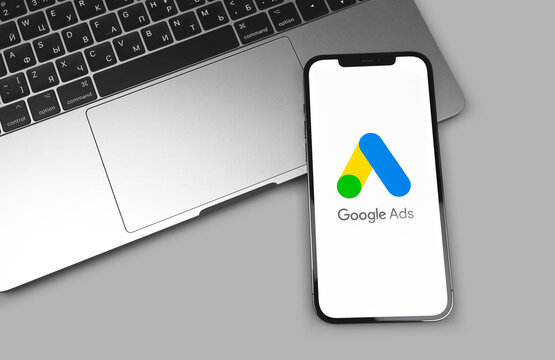 Google Ads AdWords app logo on the screen iPhone, MacBook closeup. Google is the biggest Internet search engine in the world. Moscow, Russia - December 5, 2020