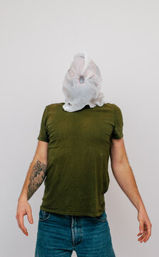 A man with a plastic bag over his head. Plastic is killing. Environmental problems