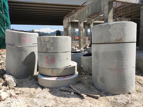 KUALA LUMPUR, MALAYSIA  -MARCH 2, 2020:  Circular shape precast concrete manhole stacked at the construction site.
