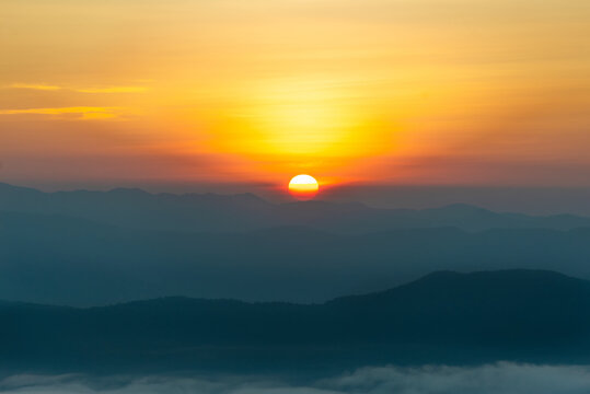 landscape in thailand sunrise on mountains peaceful with mist and sunlight at morning picturesque scenery outdoors travel.