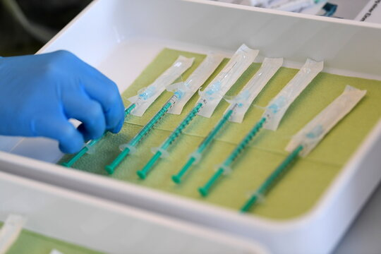 Health professional Tatjana Lang prepares syringes with doses of the Pfizer-BioNTech COVID-19 vaccine in Pfaffenhofen an der Ilm