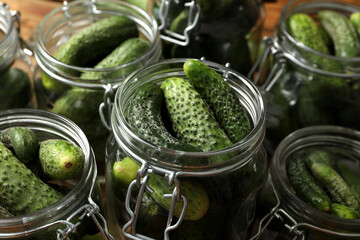 Pickling jars with fresh cucumbers, closeup view